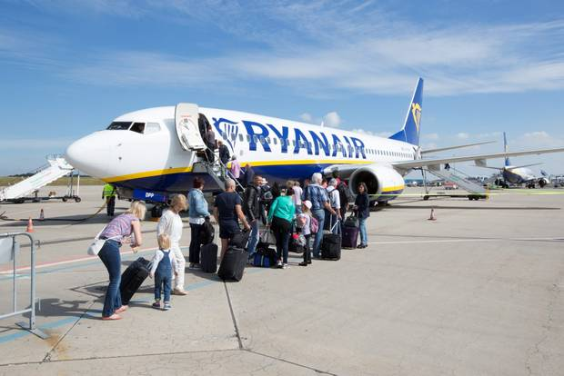 Ryanair passengers board after airline announces flight is delayed more than 3 hours.